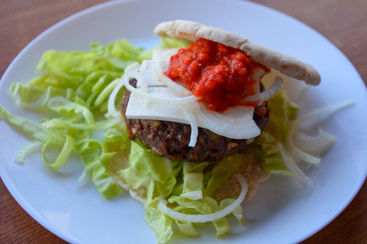 A Balkan burger, our version of pljeskavica, on a plate