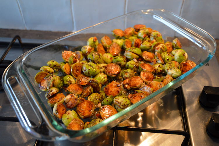 Spicy miso maple roasted brussels sprouts in a glass baking dish
