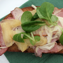 Close-up of Olomoucke Tvaruzky, meat, and greens on toast