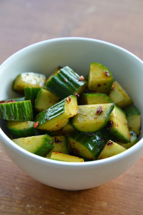 Small white bowl of Sichuan cucumber salad