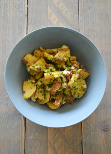Bowl with German Potato Salad on a table