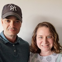 Sarah and Justin, a woman in an apron and a man in a Yankees hat, smiling