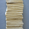 A stack of sliced tofu which will be turned into delicious Asian baked tofu