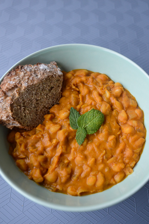 Bowl of Macedonian beans - our version of tavce gravce - with a piece of toast