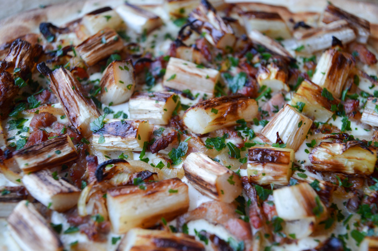 Close up of Flammkuchen with white asparagus