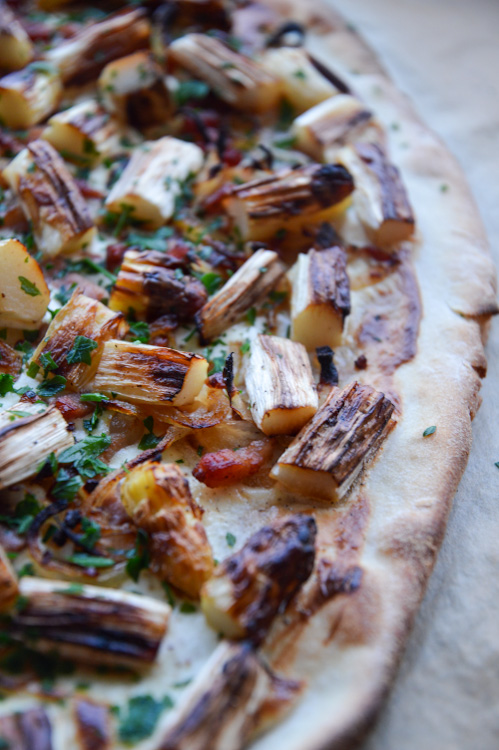 Close up of Flammkuchen with white asparagus including crust