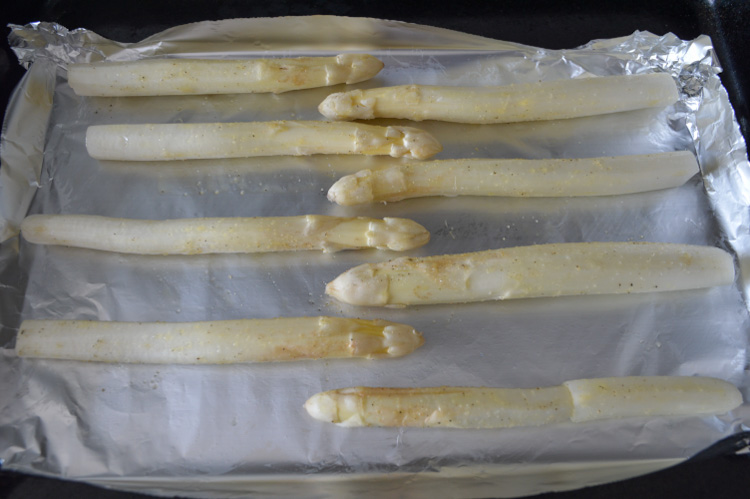 Roasted white asparagus prepped to cook in the oven