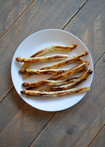 Roasted white asparagus on a white plate
