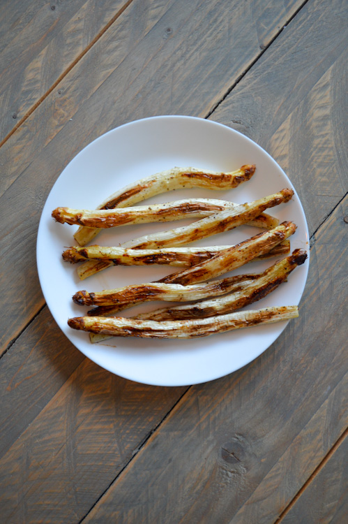 Plate of roasted white asparagus on a table