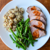 Thai Grilled Pork: sliced pork tenderloin plated with green beans and quinoa