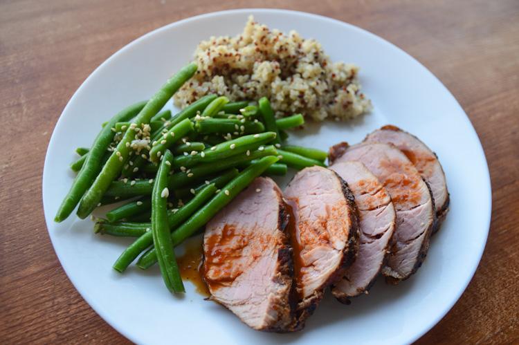 Thai Grilled Pork: pork tenderloin with sauce, green beans, & quinoa on a white plate