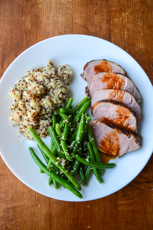 Thai Grilled Pork: sliced pork tenderloin with a sauce made from red curry paste, plated with green beans and quinoa