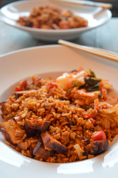 Two bowls of gochujang fried rice, one blurred in the background