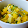 Close up of a white bowl with spicy mango salsa