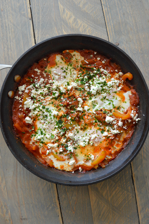 Shakshuka for two served in a skillet, topped with a sprinkle of feta cheese