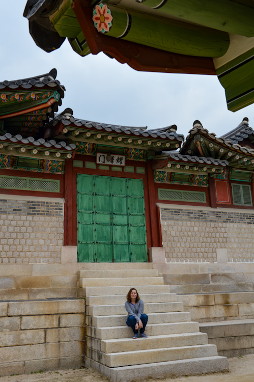 Sarah sitting on the stairs of a temple in Seoul, South Korea