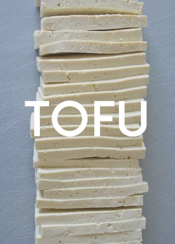 Background image: white slices of tofu; text overlay: tofu